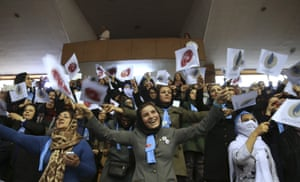 Iranian women wave flags of reformists for the parliamentary elections in a campaign rally in Tehran.