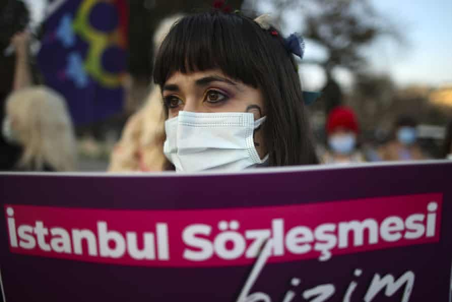 A protester holds a sign that reads 'Istanbul convention', at a demonstration in the city against Turkey's withdrawal from the accord.