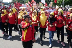 Women from labour and campaigning groups demand a democratic, prosperous, equal and violence-free life in Jakarta, Indonesia
