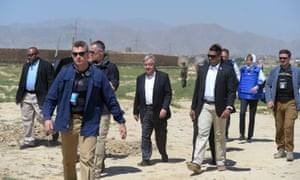 The UN's secretary general, Antonio Guterres (centre), meets displaced families on the outskirts of Kabul on Wednesday.