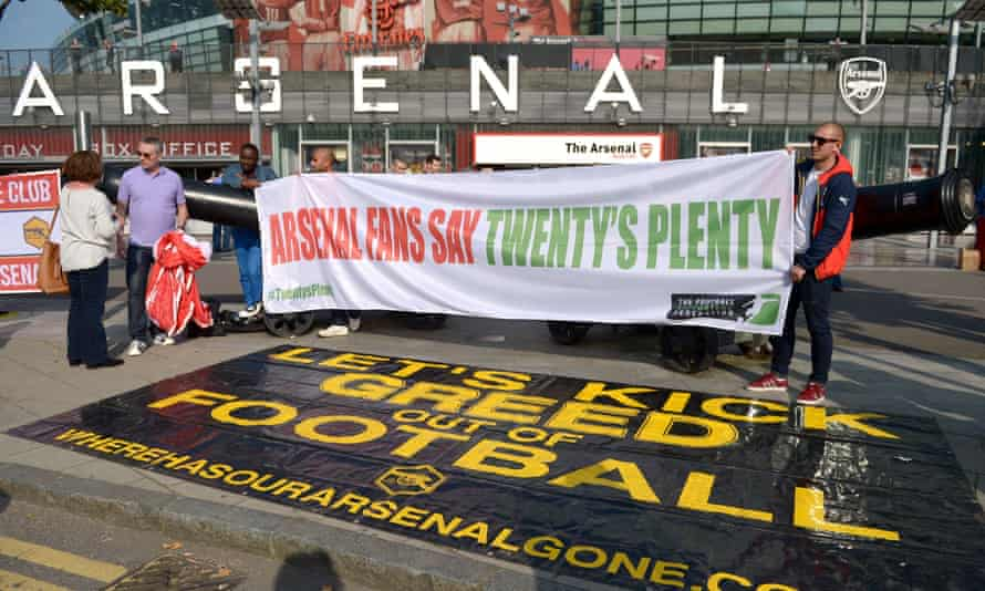 Arsenal and Manchester United fans protest outside the ground at the price of match tickets before the Premier League game at the Emirates Stadium in 2015.
