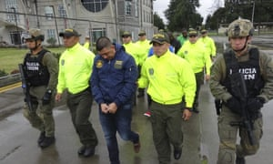 Police officers escorting a man identified as Washington Edison Prado after his arrest in Colombia in April.