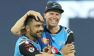 Rashid Kahn of the Strikers (left) celebrates his wicket with team mate Peter Siddle.