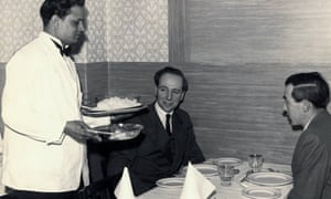 A waiter about to serve a meal in the Bombay Restaurant, Manchester, 1957.