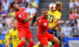 Jordan Henderson (centre) tussles with Sweden's Ola Toivonen in England's 2-0 win.