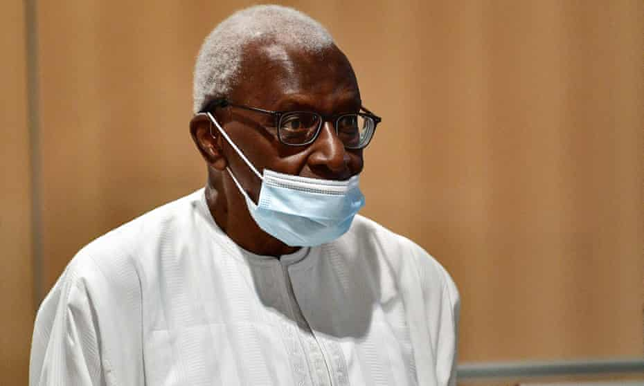 Lamine Diack appearing in court in Paris, wearing a mask