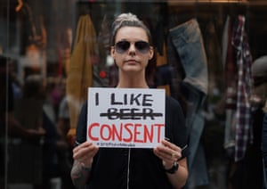 A woman holds a sign during a protest against Brett Kavanaugh outside Trump Tower in New York City on 4 October.