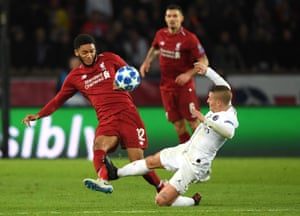 Joe Gomez of Liverpool is tackled (some say fouled) by Marco Verratti of PSG.