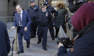Harvey Weinstein, left, leaves a Manhattan courthouse after closing arguments in his rape trial in New York.