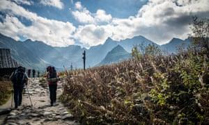 Tourists hike in the Tatra mountains, Poland.