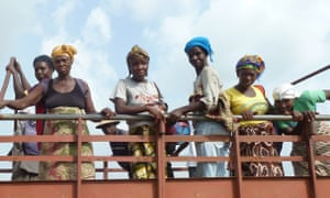 Palm oil workers in northwestern Liberia