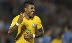 Paulinho celebrates after completing his hat-trick against Uruguay in stoppage time.