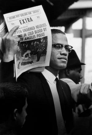 Malcolm X Holding Up Black Muslim Newspaper, 1963