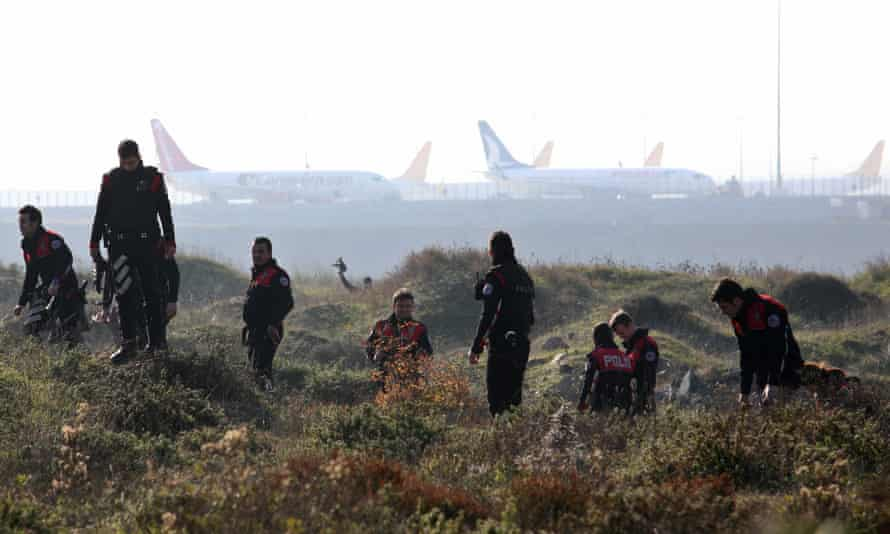 Turkish police search the area around Sabiha Gokcen international airport in Istanbul on 23 December after an explosion left one dead.