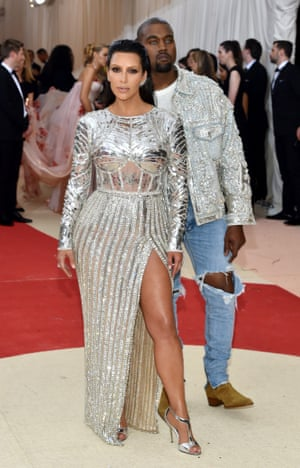 Kim Kardashian and Kanye West Gunmetal grey wasn't bling enough for the Kardashian-Wests, so they went for straight-up silver. Balmain, obvs. Kim's C3PO bodice is awesome, and the styling is on point: note the slicked back hair, and the spiky ear cuffs. Kanye's silver jacket and ripped jeans, on the other hand - really, Kanye? You think? Because you look like a country singer topping the bill at Vegas.