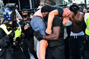 Patrick Hutchinson carries wounded man