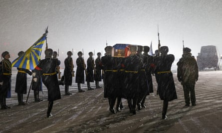 A guard of honour greets the coffin of Russian Lt Col Oleg Peshkov, pilot of the Russian plane shot down by Turkish forces last week, at a ceremony at Chkalovsky military airport, near Moscow.