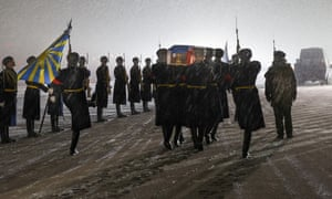 Russian military personnel carry the coffin of a Russian Su-24 bomber pilot who was killed when the plane was downed by a Turkish fighter jet.