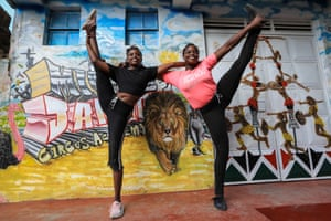 Two performers pose for a photo at the entrance of the academy in Nairobi