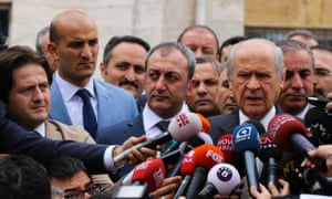Devlet Bahceli (right), leader of Nationalist Movement Party (MHP), the third largest political party in Turkey, gives a speech after casting his vote in Cankaya district in Ankara.