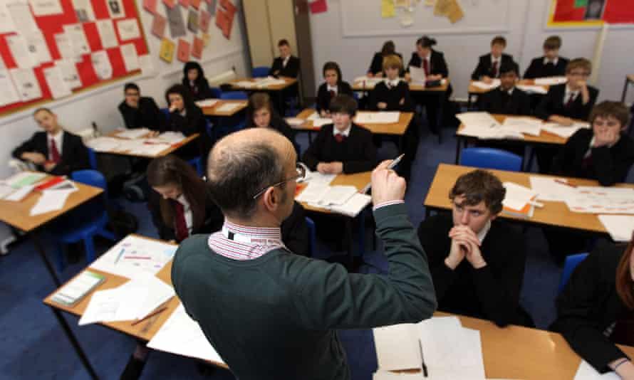A teacher and a class full of pupils