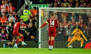 Liverpool's Mohamed Salah makes it 3-0.