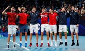 Serbia's team celebrate with Novak Djokovic, centre.