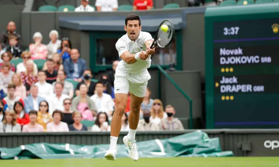 Novak Djokovic at full stretch against Jack Draper