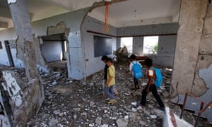 Children walk through their school, damaged by a Saudi-led air strike, in October, in Hodeidah.
