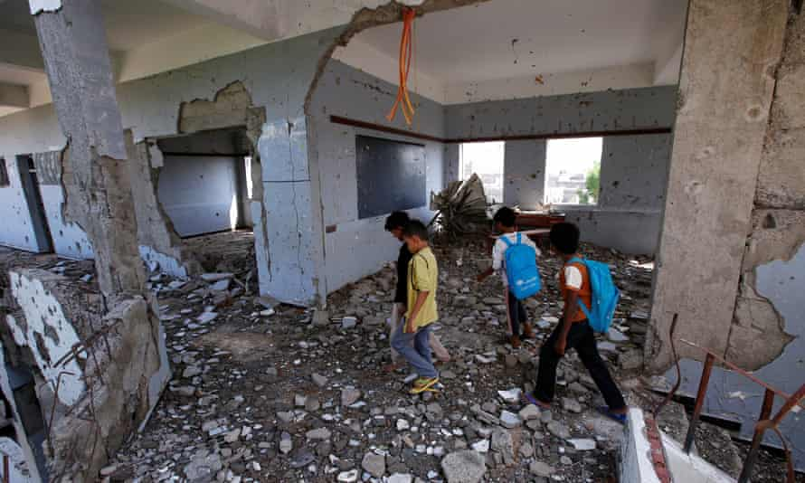 Children walk through their school, damaged by a Saudi-led air strike, in October, in Hodeidah.