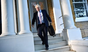 Boris Johnson leaves the London flat he shares with his partner.