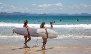 Surfers at Wategos beach in Byron Bay, New South Wales, Australia