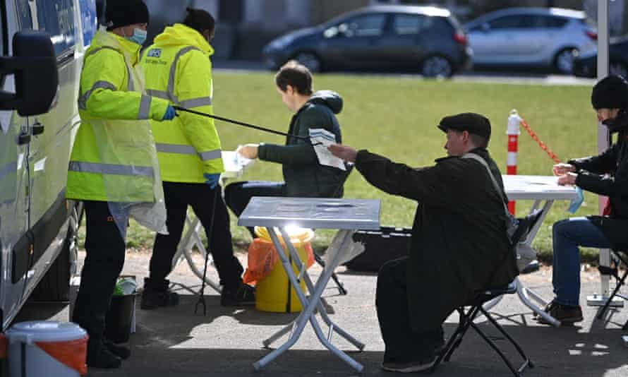 People take Covid-19 tests at a mobile surge testing centre in Brockwell Park, south London, on 13 April.