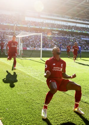Liverpool's Georginio Wijnaldum celebrates scoring their on their way to beating Cardiff City 2-0 at the Cardiff City Stadium.