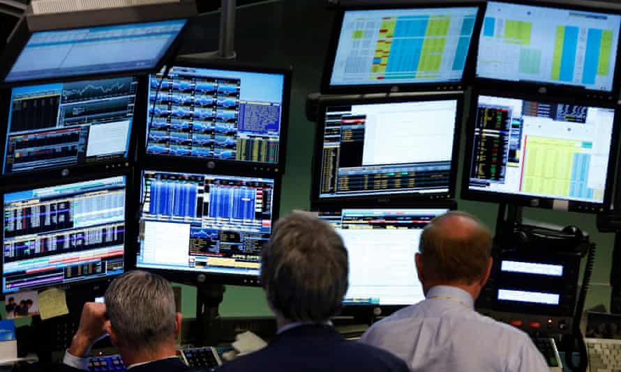 Traders in front of Bloomberg terminals at the New York Stock Exchange.