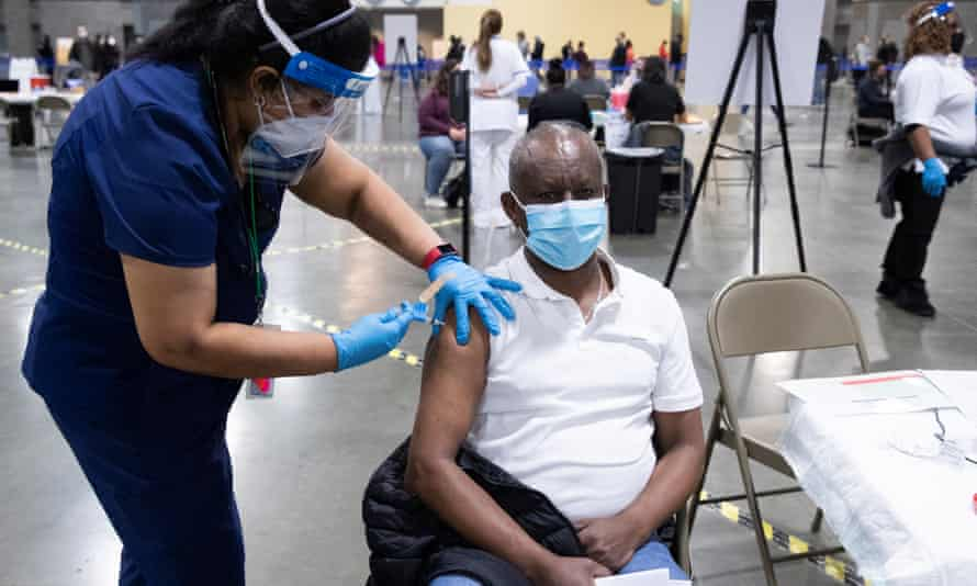 A man is inoculated with the Moderna COVID-19 vaccine at a mass vaccination event hosted by Unity Health Care, at Walter E. Washington Convention Center in Washington, DC, USA, 03 April 2021.