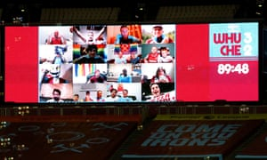 A general view of the fan wall on the big screen after West Ham United's third goal.