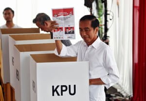Indonesian President Joko Widodo casts his ballot during elections in Jakarta.