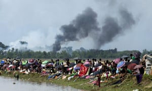 Smoke billows above what is believed to be a burning village in Rakhine state as Rohingya take shelter in a no-man's land between Bangladesh and Myanmar.