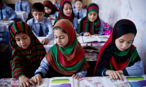 Young girls attend the first co -educational school to be opened in Kandahar, on 26 September 2016.