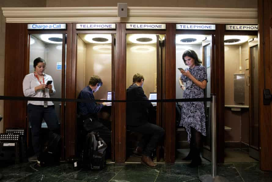 Journalists on Capitol Hill file their copy during the public hearings.