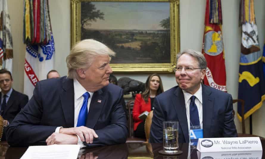 Donald Trump sits beside NRA CEO Wayne LaPierreat the White House on 1 February 2017 in Washington.