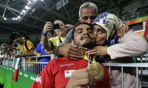 Taha Akgul's parents hug their son.