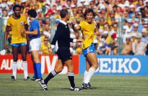 Zico complains to the referee after his shirt is ripped.