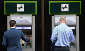 Lloyds customers withdraw money from a Cashpoint