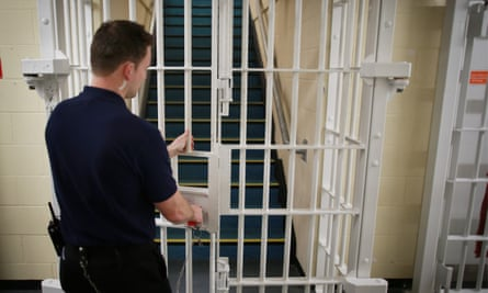 A door being closed by a prison guard at the Cookham Wood young offenders' institution