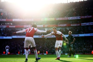 December 22: Alex Iwobi of Arsenal celebrates his goal against Burnley with Mesut Ozil.