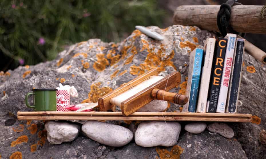A driftwood bookshelf with books on