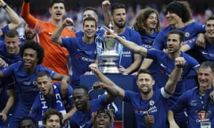 The Chelsea players celebrate after the Emirates FA Cup Final between Chelsea and Manchester United at Wembley Stadium on May 19, 2018 in London, England. Photograph by Tom Jenkins