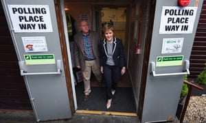 Nicola Sturgeon leaves after casting her vote with her husband, Peter Murrell, at Broomhouse community hall in Glasgow.